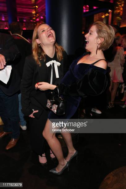 Karoline Herfurth and Jella Haase laugh during the premiere after party of Das perfekte Geheimnis at Anoki Restaurant on October 21 2019 in Munich...