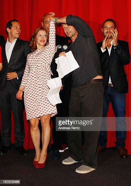 Karoline Schuch dances with Til Schweiger during the 'Schutzengel' Premiere at CineStar on September 18 2012 in Berlin Germany