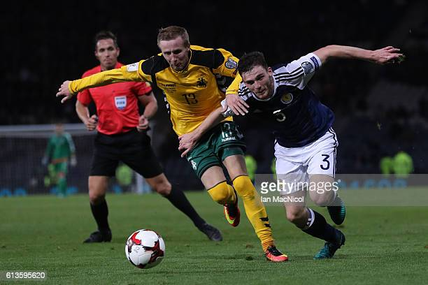 Karolis Chvedukas of Lithuania vies with Andy Robertson of Scotland during the FIFA 2018 World Cup Qualifier between Scotland and Lithuania at...