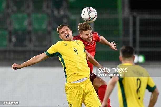 Karolis Laukzemis of Lithuania is challenged by Nico Elvedi of Switzerland during the FIFA World Cup 2022 Qatar qualifying match between Switzerland...