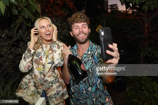 Karolína Kurková and DJ Timo Weiland attend Ruinart x Vik Muniz Art Basel Miami Beach Champagne Fête at Miami Beach Botanical Garden on December 04...