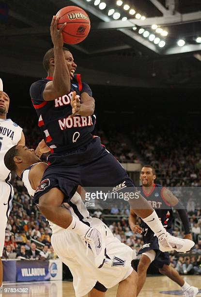 Karon Abraham of the Robert Morris Colonials passes the ball as Corey Fisher of the Villanova Wildcats defends during the first round of the 2010...