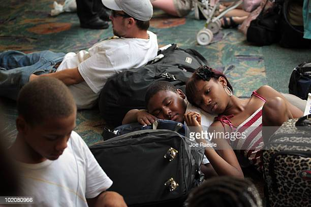 Ka'Ron Young and Kier'Ra Freeman rest on the floor after returning from a cruise ship vacation with their family to find out that all Spirit Airlines...