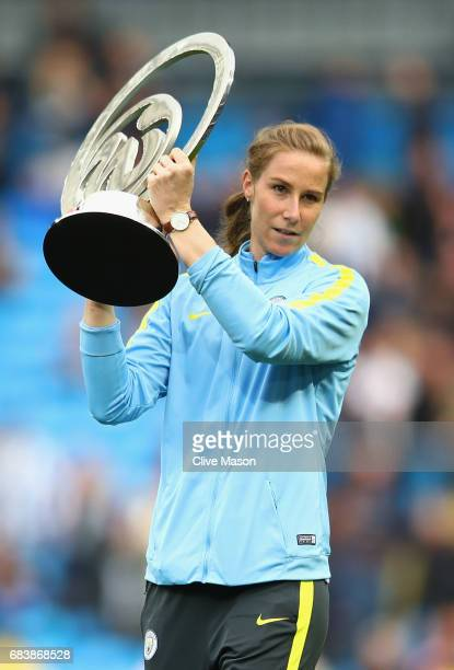 Karren Bardsley of Manchester City laddies team presents the Women's Super League 1 trophy to the Manchester City fans prior to the Premier League...