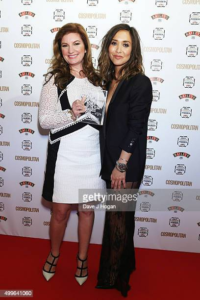 Karren Brady and Myleene Klass pose for a photo with the award for Business Woman during the Cosmopolitan Ultimate Women Of The Year Awards at One...