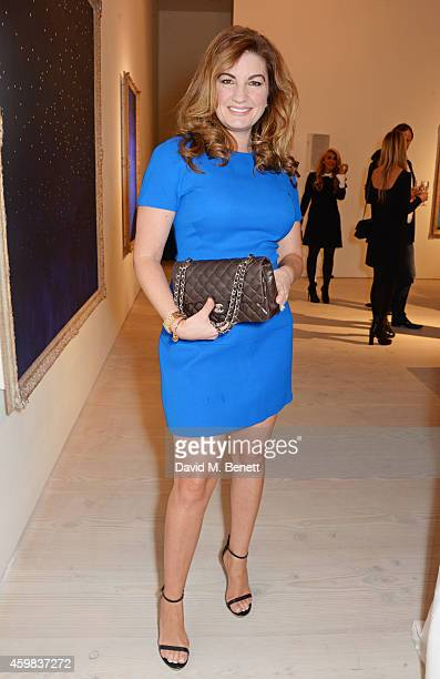"""Karren Brady attends a private view of """"And The Stars Shine Down"""" by Stasha Palos at the Saatchi Gallery on December 2, 2014 in London, England."""