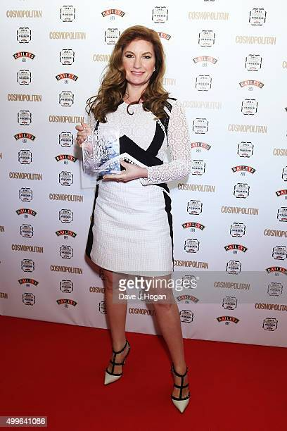 Karren Brady poses for a photo with the award for Business Woman during the Cosmopolitan Ultimate Women Of The Year Awards at One Mayfair on December...
