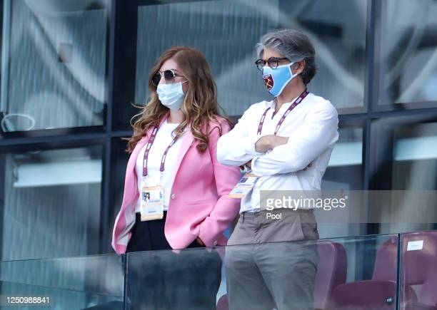 Karren Brady, Vice-Chairman of West Ham United and her husband Paul Peschisolido are seen in the directors box wearing PPE prior to the Premier...