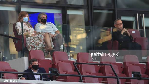 Karren Brady, vice-chairperson of West Ham and David Sullivan owner of West Ham look on from the stands during the Premier League match between West...