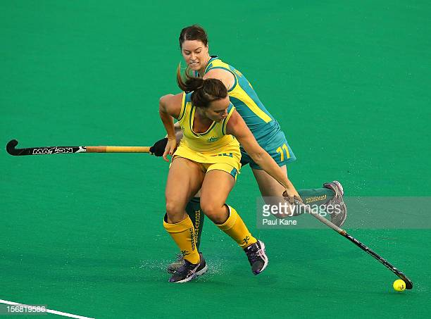 Karri McMahon of the Jillaroos contests for the ball against Georgie Parker of the Hockeyroos during the womens Australia v Australia under 21 game...