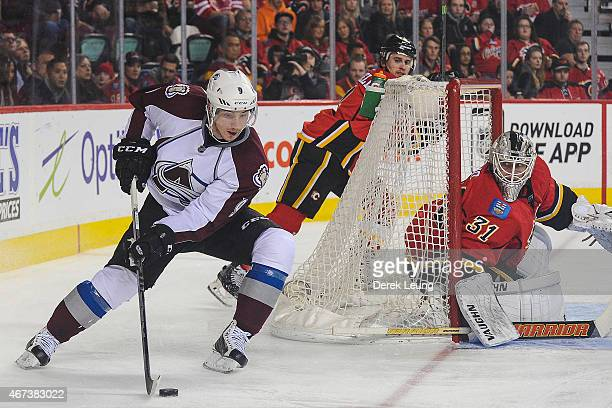 Karri Ramo of the Calgary Flames defends the net against Matt Duchene of the Colorado Avalanche during an NHL game at Scotiabank Saddledome on March...
