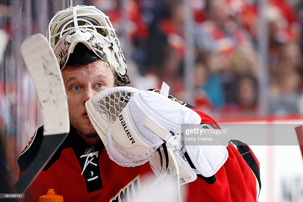 Karri Ramo #31 of the Calgary Flames waits at the bench during a TV timeout in the game against the Winnipeg Jets at Scotiabank Saddledome on April 11, 2014 in Calgary, Alberta, Canada.
