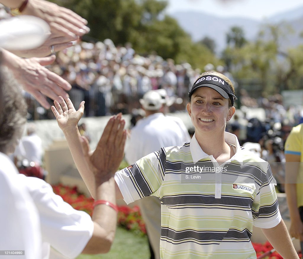 Karrie Webb gives high-fives to fans at the Kraft Nabisco Championship at The Mission Hills Country Club in Rancho Mirage, California on Sunday, April 2, 2006.