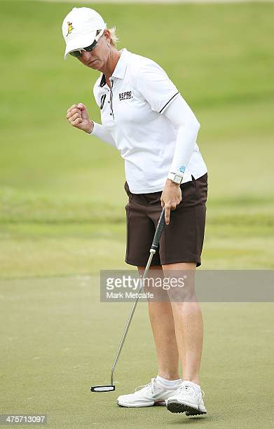 Karrie Webb of Australia celebrates making a birdie on 18th hole during the third round of the HSBC Women's Champions at the Sentosa Golf Club on...