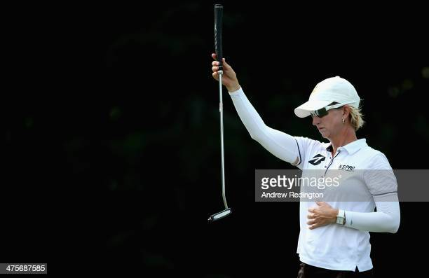 Karrie Webb of Australia lines up a putt on the first hole during the third round of the HSBC Women's Champions at the Sentosa Golf Club on March 1...
