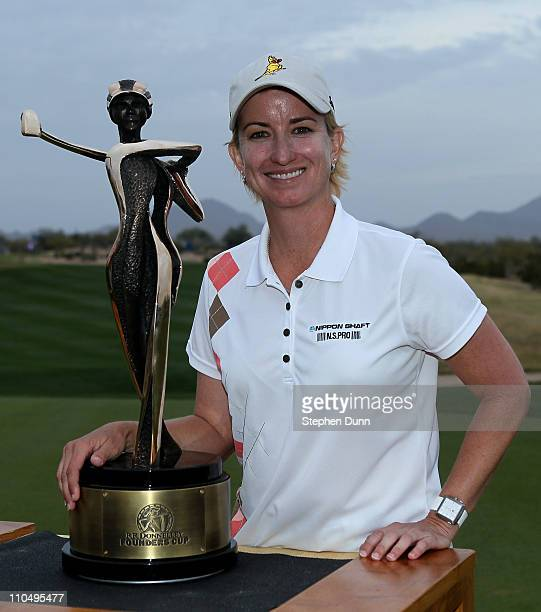 Karrie Webb of Australia poses with the championship trophy after the final round of the RR Donnelley LPGA Founders Cup at Wildfire Golf Club on...