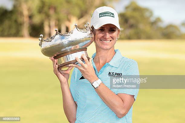 Karrie Webb of Australia poses with the winners trophy after winning the tournament of the ISPS Handa Women's Australian Open at The Victoria Golf...