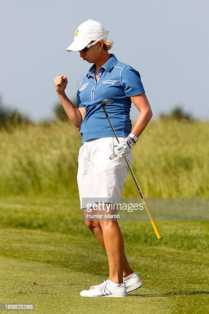 Karrie Webb of Australia reacts after hitting her third shot on the 18th hole during the final round of the ShopRite LPGA Classic Presented by Acer...