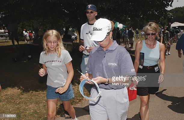 Karrie Webb of Australia signs autographs for fans during the third round of the Jamie Farr Kroger Classic on July 13, 2002 at Highland Meadows GC in...