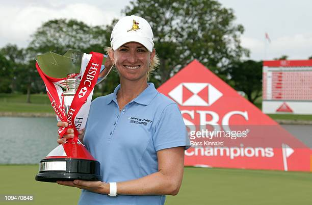 Karrie Webb of Australia with the winners trophy after the final round of the HSBC Women's Champions at Tanah Merah Country Club on February 27 2011...