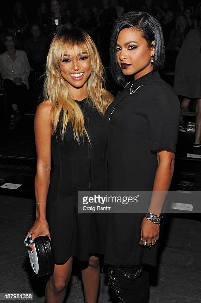 Karrueche Tran and Christina Milian attend the Alexander Wang Spring 2016 fashion show during New York Fashion Week at Pier 94 on September 12 2015...
