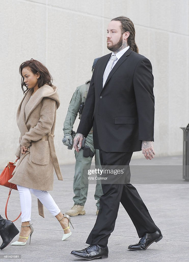 Karrueche Tran (L), Chris Brown's girlfriend, and Chris Hollosy, Brown's bodyguard, leave court where Hollosy and Brown's attorneys rejected a plea deal that would have found them guilty of simple assault on January 8, 2014 in Washington, DC. Hollosy and Brown face a misdemeanor assault charge for allegedly punching a man in the face in October 2013.