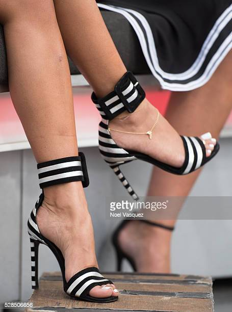Karrueche Tran shoe detail visits 'Extra' at Universal Studios Hollywood on May 5 2016 in Universal City California