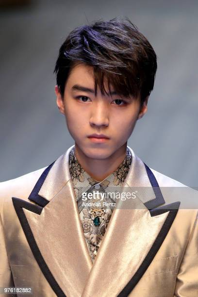 Karry Wang walks the runway at the Dolce Gabbana show during Milan Men's Fashion Week Spring/Summer 2019 on June 16 2018 in Milan Italy