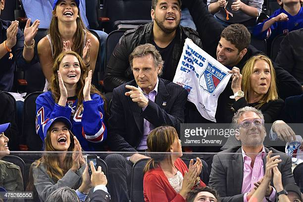 Karsen Liotta Liam Neeson and Freya St Johnston attend the Tampa Bay Lightning vs New York Rangers playoff game at Madison Square Garden on May 29...