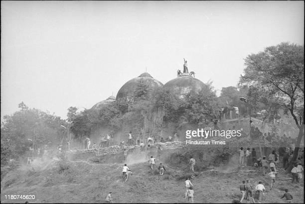 Karsevaks atop the Babri masjid shortly before it was demolished on December 6 1992 at Ayodhya
