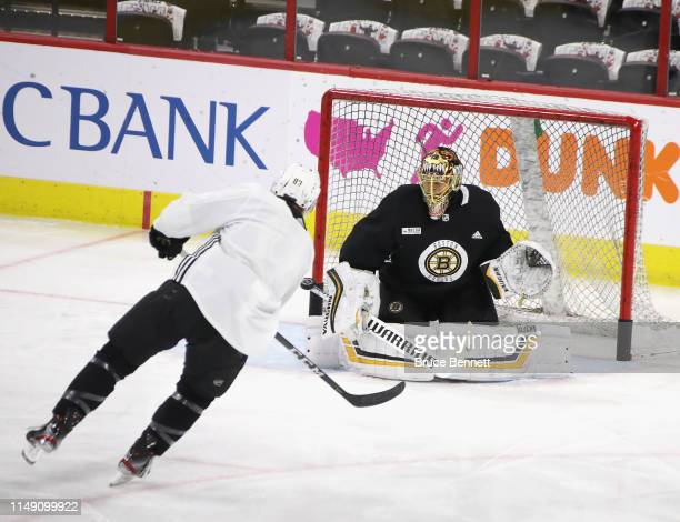 Karson Kuhlman and goaltender Tuukka Rask of the Boston Bruins take part in the morning skate prior to Game Three of the Eastern Conference Final...