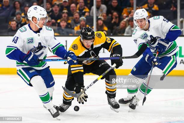 Karson Kuhlman of the Boston Bruins catches the puck during a game against the Vancouver Canucks at TD Garden on February 4 2020 in Boston...