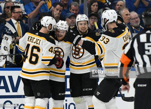 Karson Kuhlman of the Boston Bruins is congratulated after scoring a goal against the St Louis Blues in Game Six of the 2019 NHL Stanley Cup Final at...