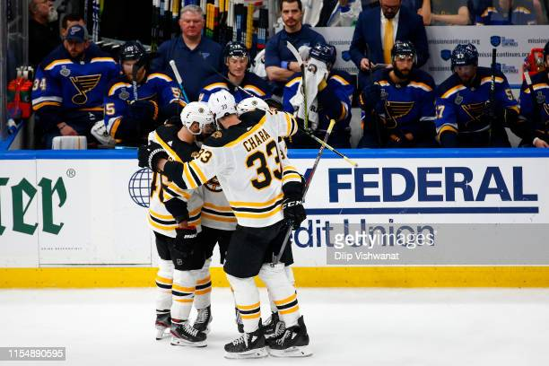 Karson Kuhlman of the Boston Bruins is congratulated by his teammates after scoring a third period goal against the St Louis Blues in Game Six of the...