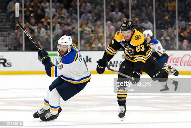 Karson Kuhlman of the Boston Bruins jumps around Joel Edmundson of the St Louis Blues and pursues the puck during the second period of the 2019 NHL...