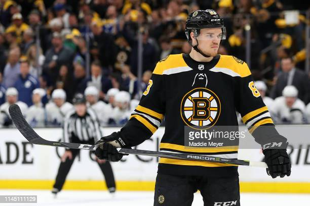 Karson Kuhlman of the Boston Bruins looks on during the third period of Game Seven of the Eastern Conference First Round against the Toronto Maple...