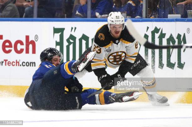 Karson Kuhlman of the Boston Bruins plays the body on Zach Sanford of the St Louis Blues during the second period of Game Six of the 2019 NHL Stanley...