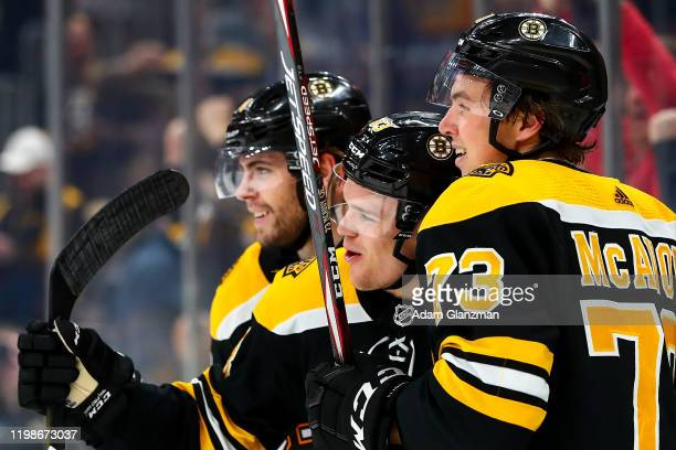 Karson Kuhlman of the Boston Bruins reacts after scoring a goal in the third period of a game against the Vancouver Canucks at TD Garden on February...