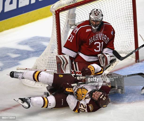 Karson Kuhlman of the Minnesota-Duluth Bulldogs colldes with Merrick Madsen of the Harvard Crimson during game one of the 2017 NCAA Division I Men's...