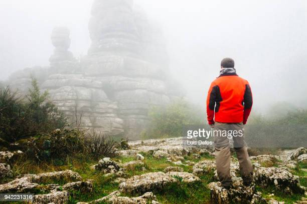 karst landscape in the fog - paraje natural torcal de antequera fotografías e imágenes de stock