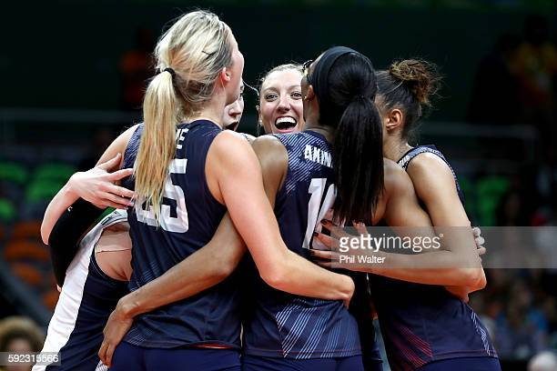 Karsta Lowe Foluke Akinradewo Jordan LarsonBurbach of United States celebrate after winning match point during the Women's Bronze Medal Match between...