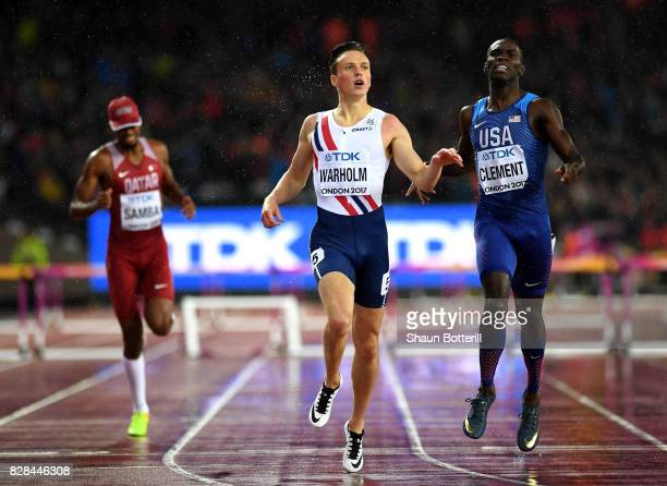 Karsten Warholm of Norway and Kerron Clement of the United States cross the finish line in the Men's 400 metres hurdles during day six of the 16th...
