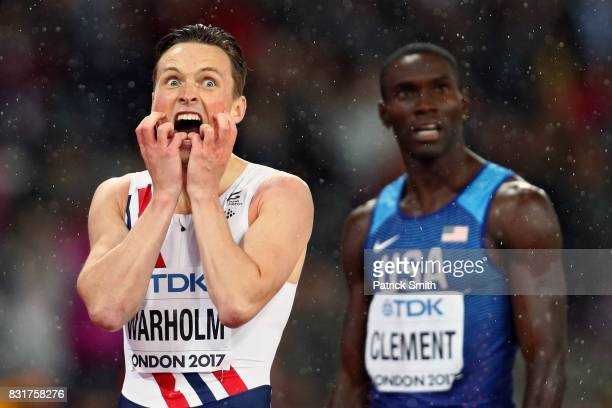 Karsten Warholm of Norway and Kerron Clement of the United States react after crossing the finish line in the Men's 400 metres hurdles during day six...
