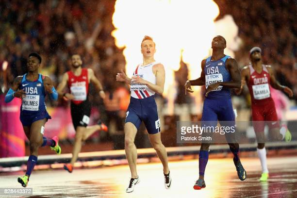 Karsten Warholm of Norway crosses the finishline to win gold in the Men's 400 metres hurdles final ahead of Kerron Clement of the United States...