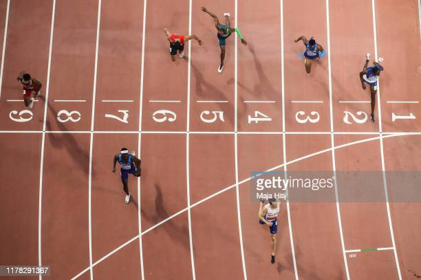 Karsten Warholm of Norway crosses the line to win gold in the Men's 400 metres hurdles final ahead of Rai Benjamin of the United States and...