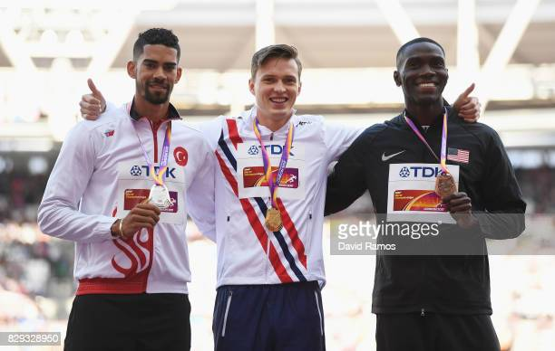 Karsten Warholm of Norway Yasmani Copello of Turkey and Kerron Clement of the United States pose with their medals won following the mens 400m...