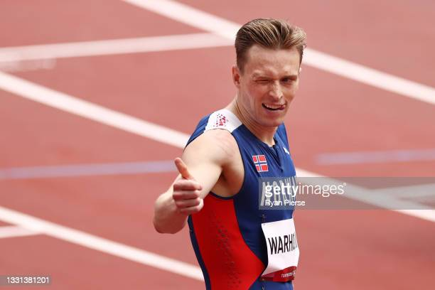 Karsten Warholm of Team Norway reacts after competing during round one of the Men's 400m hurdles heats on day seven of the Tokyo 2020 Olympic Games...