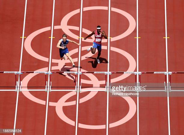 Karsten Warholm of Team Norway runs ahead of Rai Benjamin of Team United States in the Men's 400m Hurdles Final on day eleven of the Tokyo 2020...