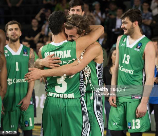 Kartal Ozmizrak #3 and Dogus Ozdemiroglu #18 of Darussafaka Istanbul celebrates at the end of the 7DAYS EuroCup Basketball Finals game two between...