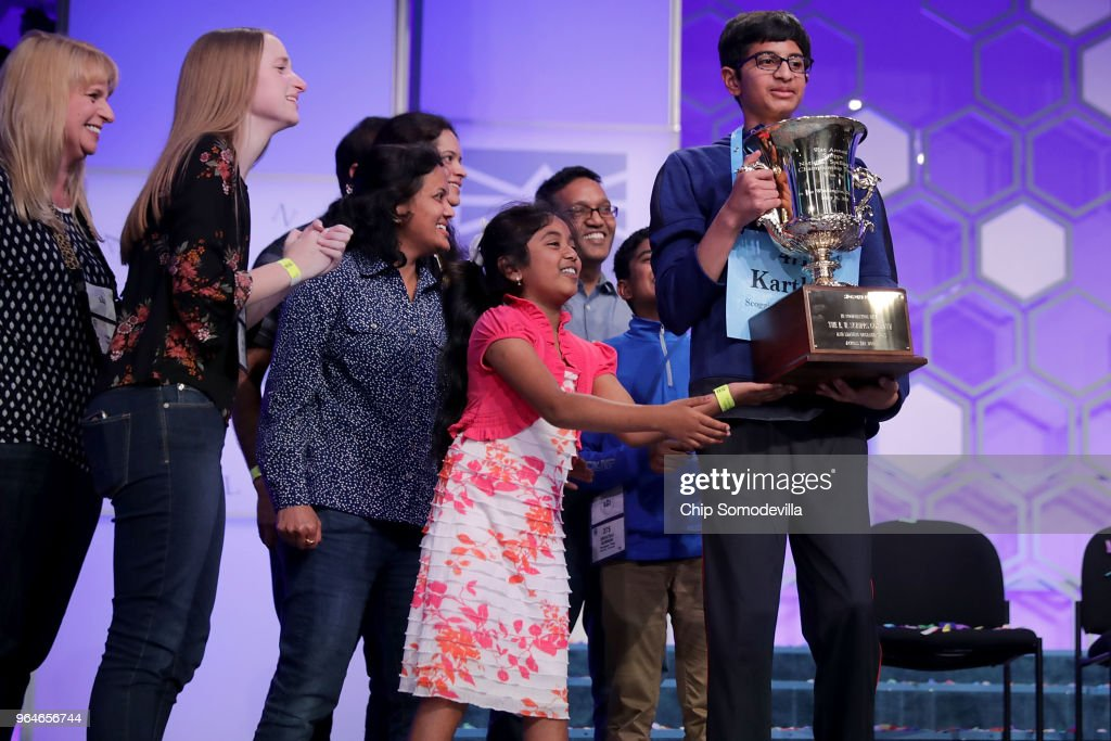 Karthik Nemmani (R) is surrounded by family and friends after he correctly spelled the word 'koinonia' to win the 91st Scripps National Spelling Bee at the Gaylord National Resort and Convention Center May 31, 2018 in National Harbor, Maryland. Forty one finalists were selected to participate in the final day after a record 516 spellers were officially invited, up from 291 in 2017 .